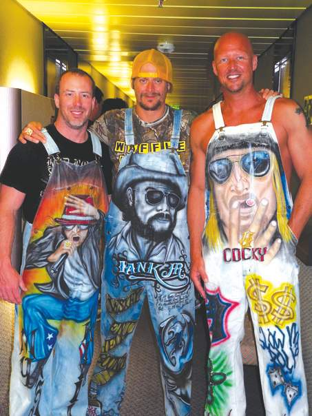 Pictured from left are Du Quoin chiropractor Rob Eaton, rock singer Kid Rock and financial planner Monte Kuhnert on the last Kid Rock Cruise. Pairs of hand-painted overalls by Du Quoin artist Keith Bell brought them together and they have all been friends ever since.