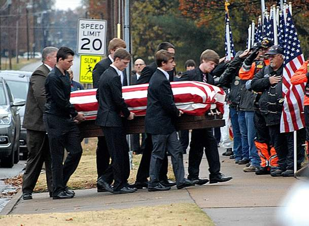 The casket of PFC Tyler Iubelt is carried into the First Baptist Church in Du Quoin at the start of the 10:30 a.m. funeral service.