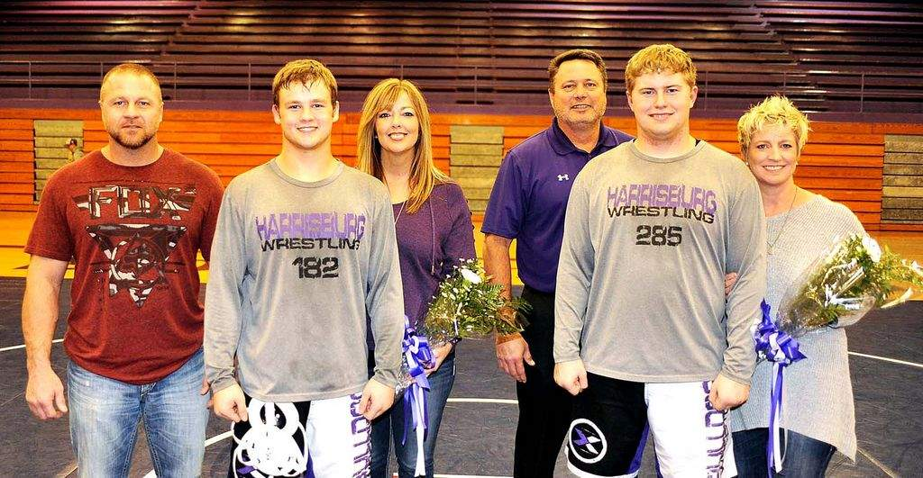 Two Harrisburg wrestlers were honored as part of Senior Night festivities Tuesday at Davenport Gymnasium when the Bulldogs took on Carmi-White County. Recognized were (left) Ryan Ragsdale with parents Bobby Ragsdale and Stacy Ragsdale and (right) Chase McDaniel with parents Kenny McDaniel and J.J. McDaniel.