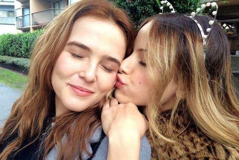"""Sam Kingston (""""Vampire Academy"""" star Zoey Deutch) receives support from her nasty best friend (Halston Sage) in the teen fantasy """"Before I Fall."""""""