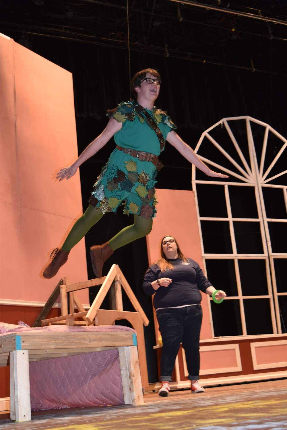 Jack Gulley flies across the state as Peter Pan in technical rehearsal Monday evening while director Hannah Drake watches at Southeastern Illinois College.
