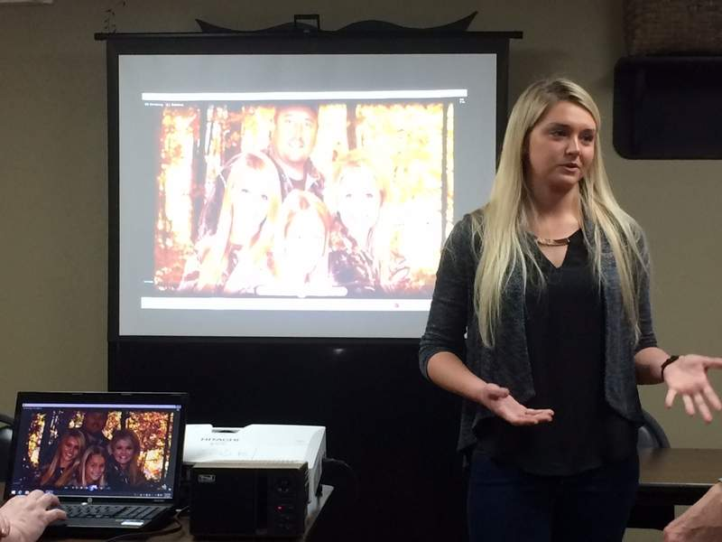 """Alli Armstrong presents photos and video of her family and their TV show, """"Grace, Camo & Lace"""" at the Eldorado Rotary."""