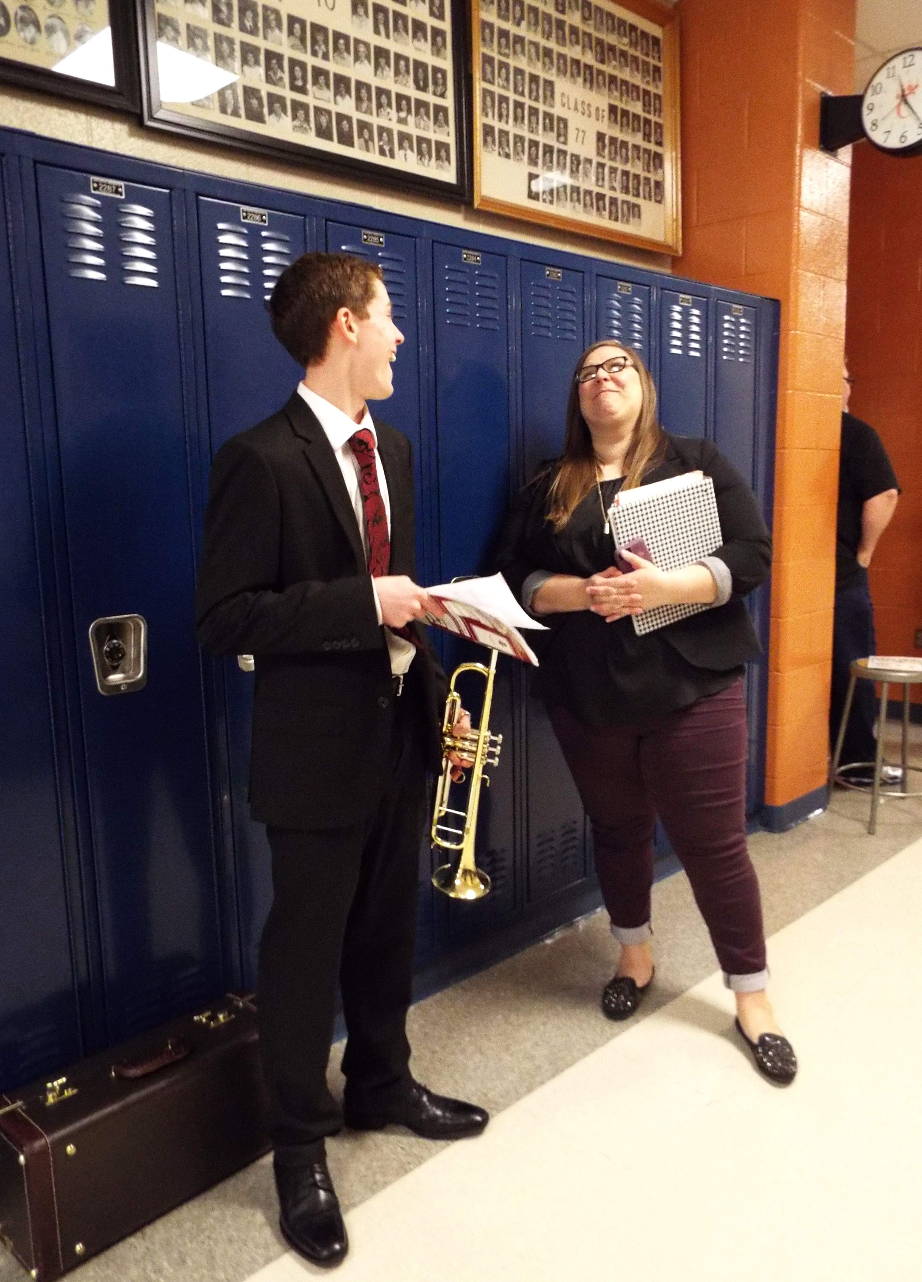 Landon Gates gets some last-minute encouragement from Harrisburg High School Band Director Hannah Drake.