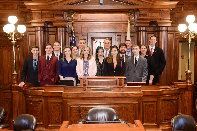 Southeastern's state champion MIG team poses at the Capitol with State Senator Dale Fowler.  Pictured are (l-r) Braden Scroggins, William Tippett, Nolan Sutton, Morgan Denbo, Head Delegate Tracy Stokich, Ryan Dennison, Reagan Gray, Casper Johns, Sen. Dale Fowler, Chloe Brandon, Evan Doughty, Grant Loudy, William Johnson, Senior delegate Dana Hooven and Advisor Matt Lees.