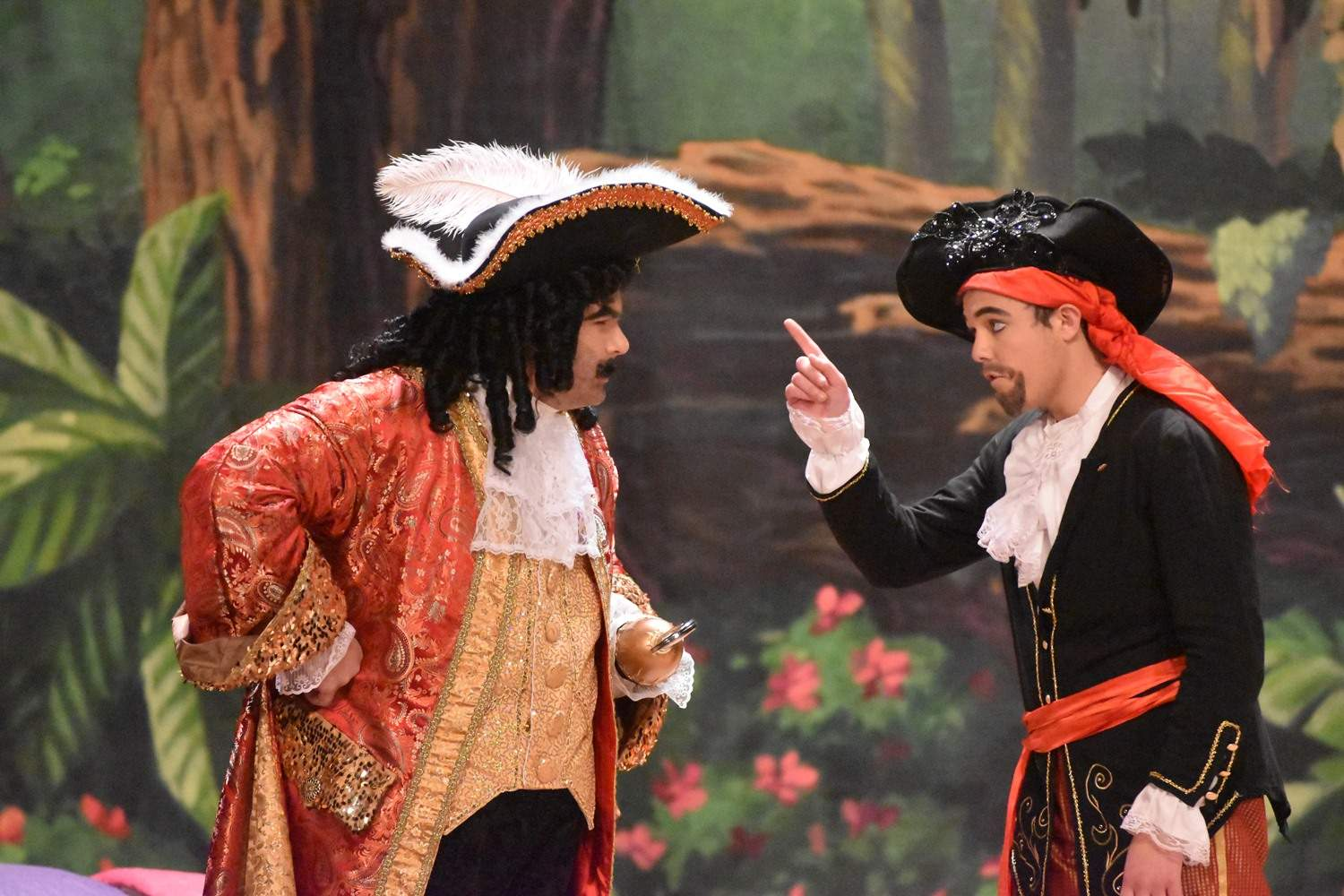 Captain Hook (Alex McRoy) argues with Smee (Braden Cummins) over Hook's plan for revenge to capture and kill Peter Pan.