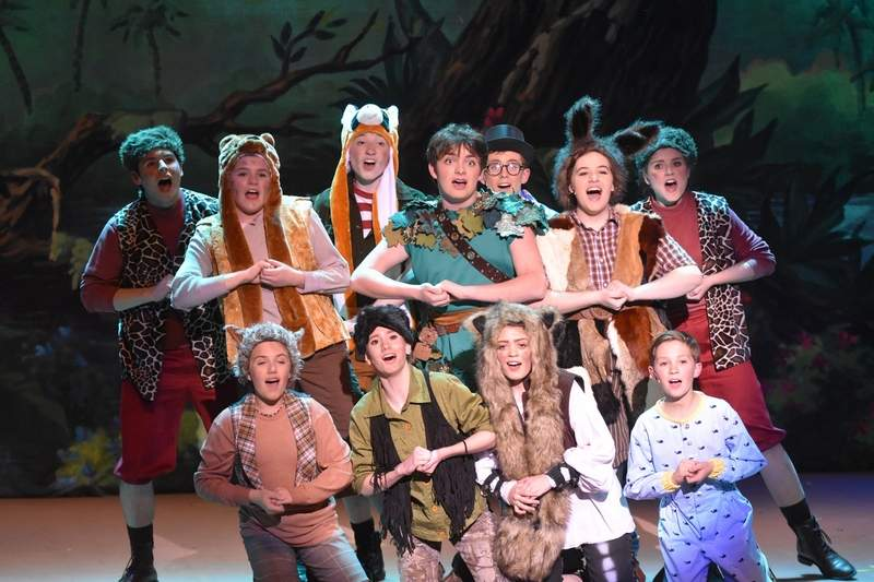 Peter Pan and the Lost Boys sing together.