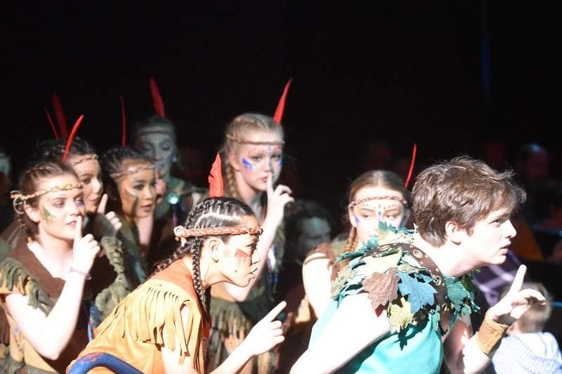 Peter Pan (Jack Gulley) and Indian princess Tiger Lilly (Jasmine Teston) lead the Indians on a secret raid of Captain Hook's ship.