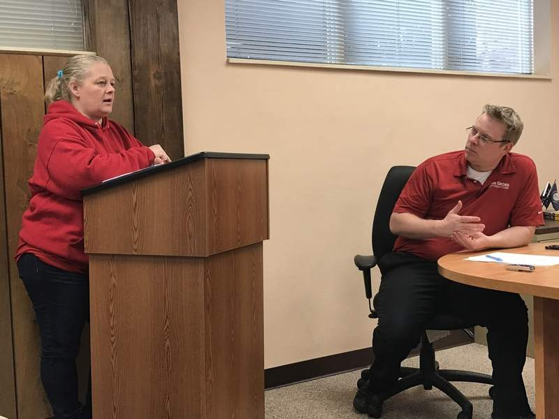 Perry County solid waste management officer Rebecca Tracy speaks Thursday to the Perry County Board as County Clerk Josh Gross looks on.