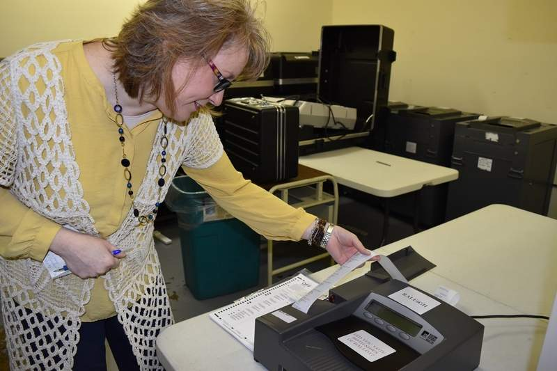 Saline County Clerk Kim Buchanan reads the results of a voting machine test Tuesday morning. The consolidated election is April 4.