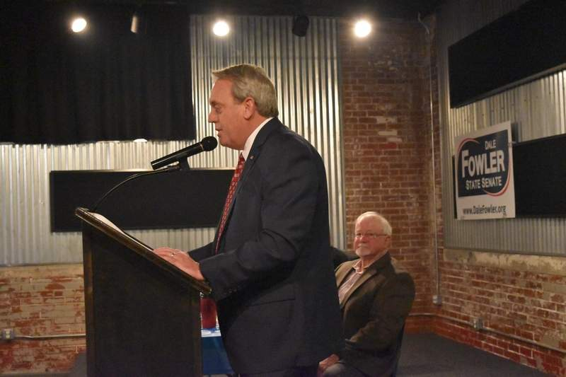 Sen. Dale Fowler, R-Harrisburg, speaks at the Saline County Republicans' annual Lincoln Day Dinner Saturday at Morello's in Harrisburg as Saline County Republican Chairman Bob Holmes listens to Fowler's remarks.