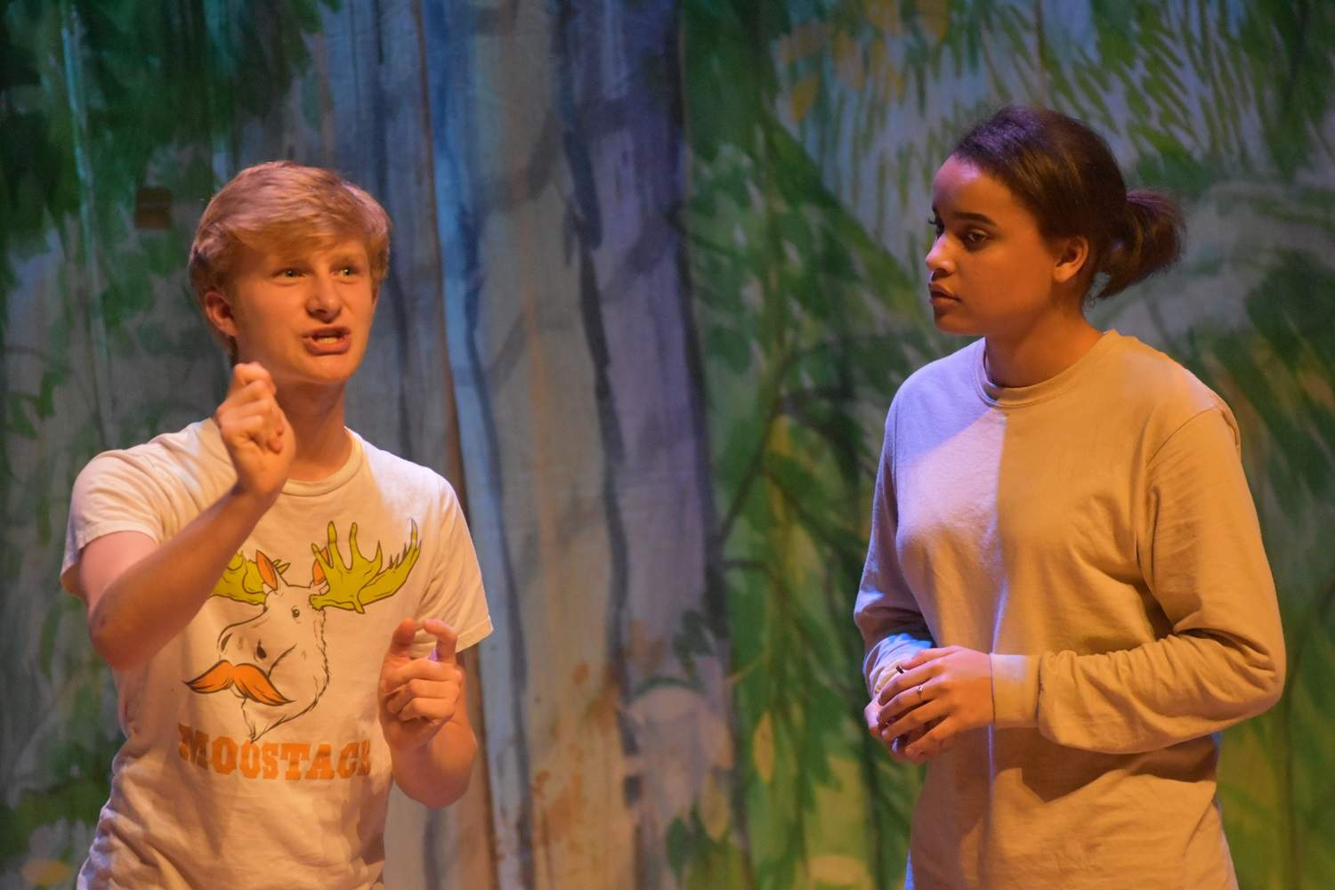 Rumpelstiltskin, left, played by Kale Rister, hatches a plan to trick the Miller's Daughter, played by Kyllah Glass, during practice for Carrier Mills-Stonefort High School's production of 'Rumpelstiltskin.'