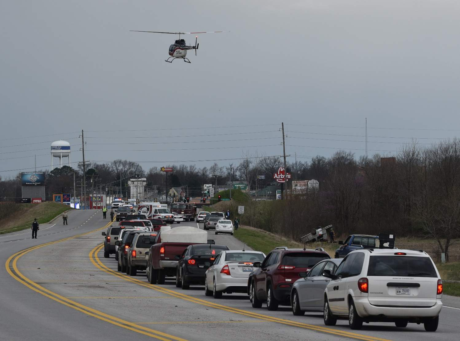 A Lifeflight helicopter prepares to land after police and emergency workers responded to a one-car wreck north of Harrisburg. U.S. 45 was shut down as a result.