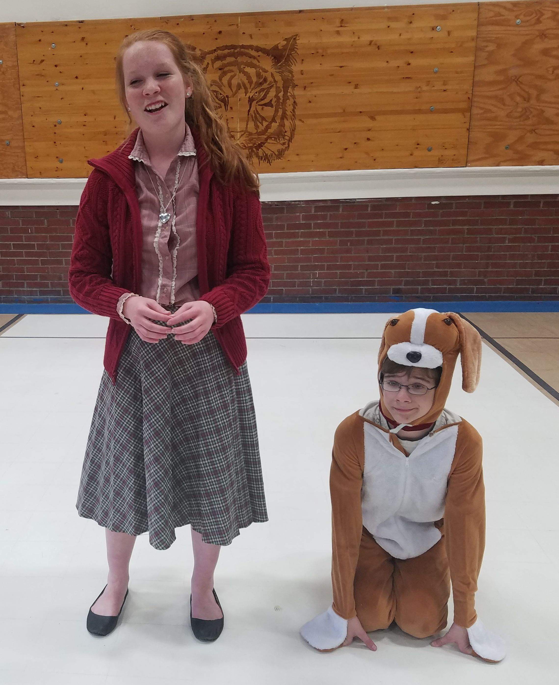 It may be a hard-knock life, but Thompsonville freshman Chloe Mays made it look easy during Monday's dress rehearsal. Mays, pictured here with eigth-grader Aaron Wade as 'Sandy,' was in character as the lovable orphan Annie and rehearsing the signature song 'Tomorrow' from the Broadway hit. The Thompsonville Schools Drama Department will present 'Annie Jr.' at 7 p.m. March  31 to April 1 at Community of Christ Church in Thompsonville. Tickets are $5 for adults, $3 for ages 4 to 17, and free to those age 3 and under. The show is directed by junior high social studies teacher Kim Ward. This will mark Ward's directorial debut, but she is no stranger to the stage, having acted in several productions at Johnston City High School.