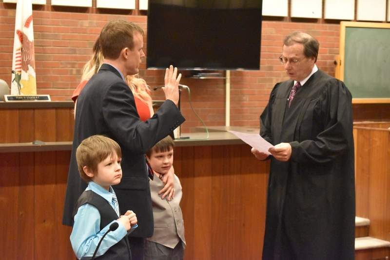 Saline County State's Attorney Jayson Clark of Eldorado, accompanied by his family, is sworn in by Judge Walden Morris at the Saline County Courthouse in Harrisburg Friday morning.