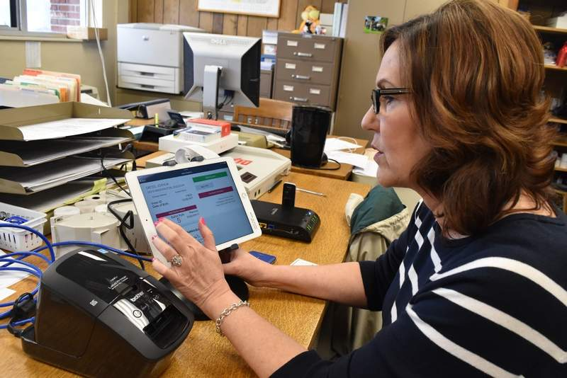 Perry County elections deputy Yvonne Morris shows off one of the new electronic poll books last week at the Perry County Government Building.