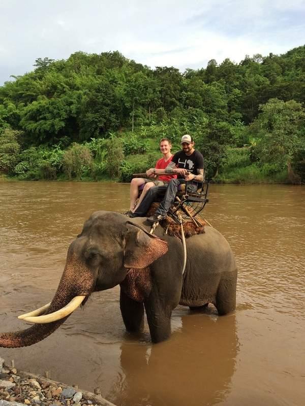 Joseph Kosma rides an elephant in Thailand.