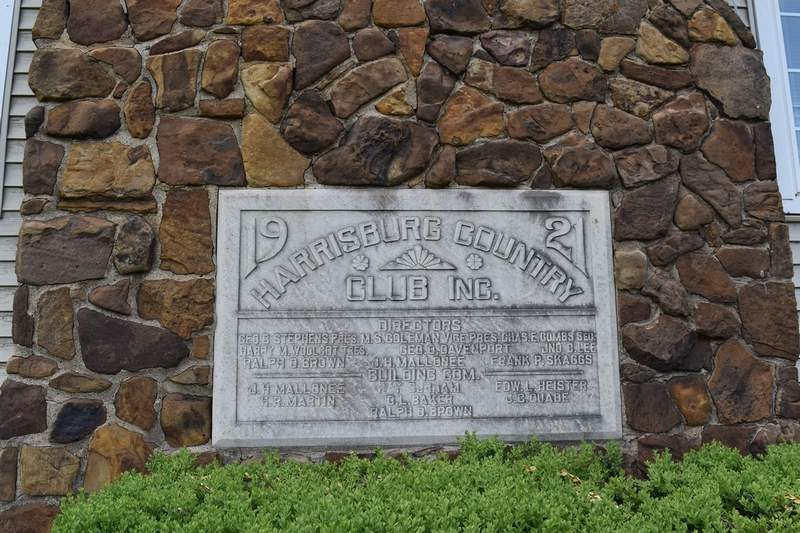 The keystone in the chimney of the club house inspired Jerry King to write his history of the golf club.