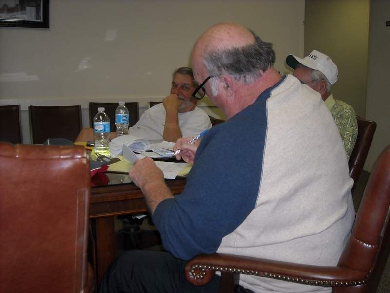 The Franklin County Board learned Monday the county has about $393,000 in the bank, which will make it difficult to make the $400,000 payroll due later this month. Shown is board member Jack Warren signs his name to one of the claims turned in for repayment.