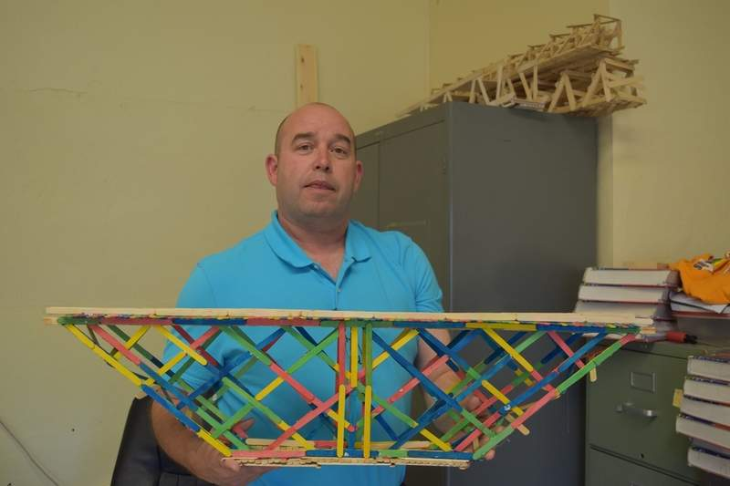 Manier displays another Geometry Concepts project, a popsicle-stick bridge.