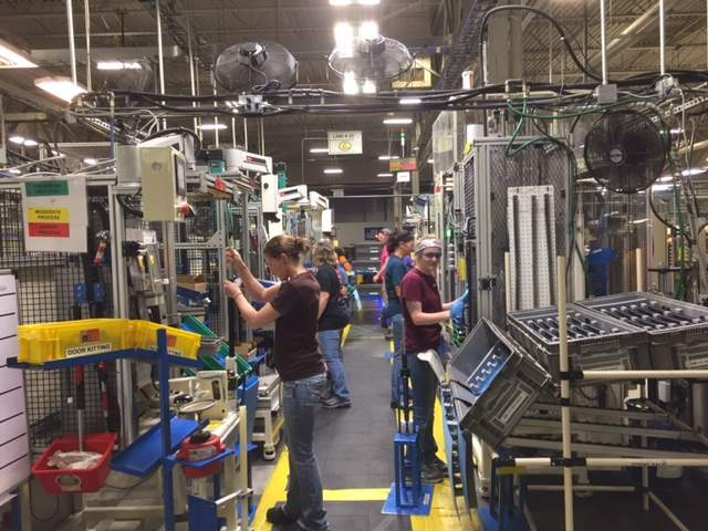 Workers at Aisin Manufacturing in Marion are shown here busy producing power back-door units for a Lexus automobile.