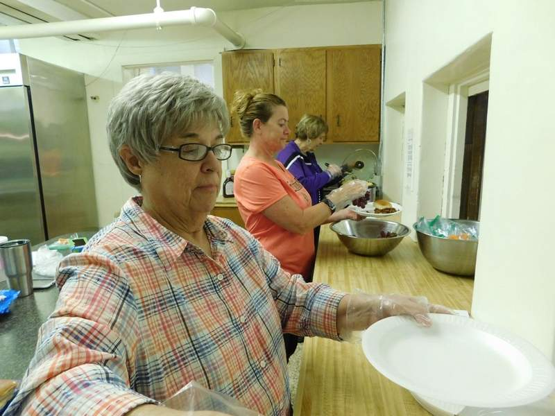 Mary Lou Payne, Darla Brachear and Mary Nix served lunch to more than 20 'customers' Monday at First Christian Church in Benton. Organizer Becky Mandrell said the funds for the program come from donations by church members. 'We are a very giving bunch,' she said with a smile.