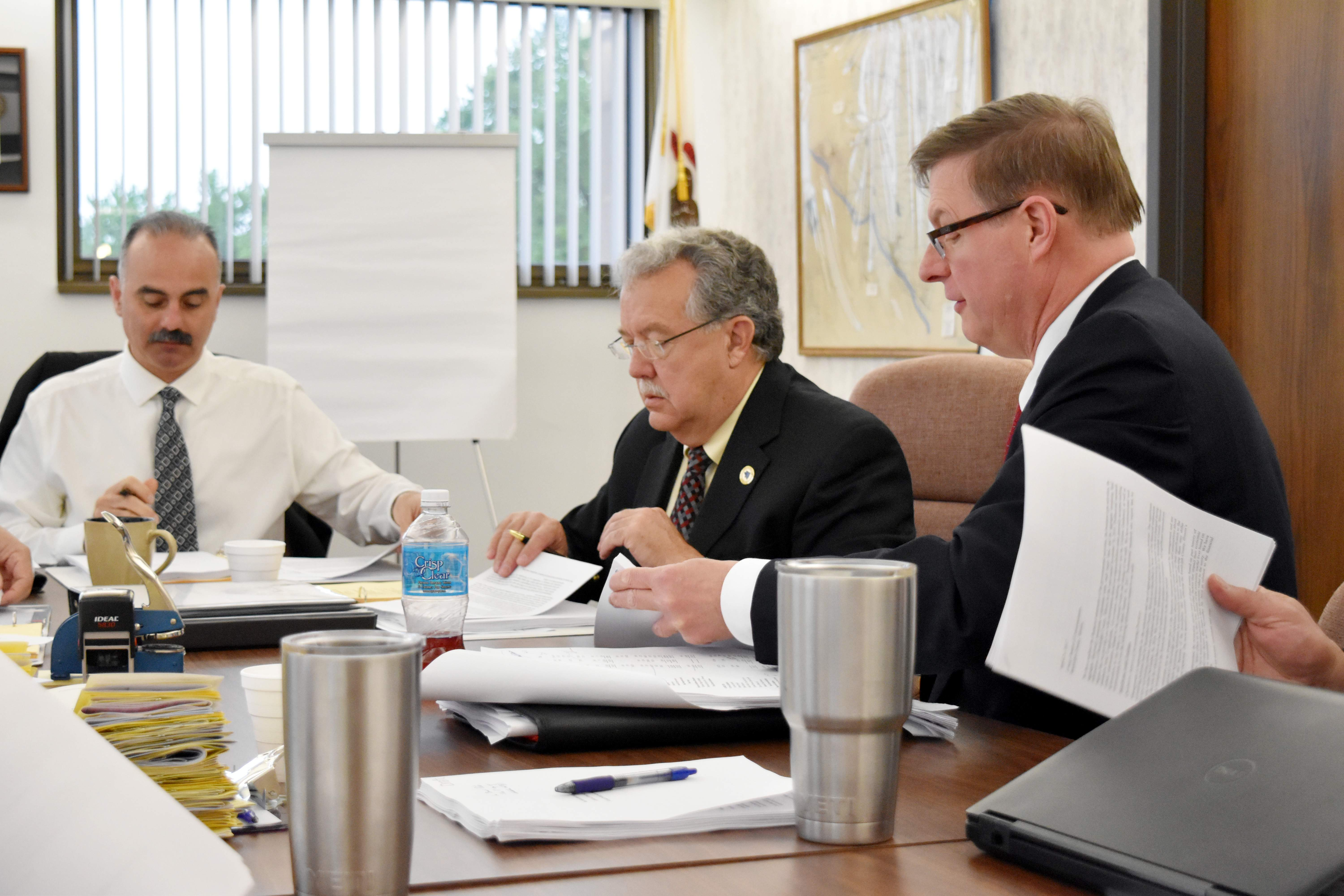 Jim Schmersahl (right), Randolph County's CPA, looks at budget documents during a discussion of the county's fiscal year 2016 audit with the county commissioners on April 21. Also pictured is Board Chairman Ronnie White (left) and Commissioner Marc Kiehna (center).