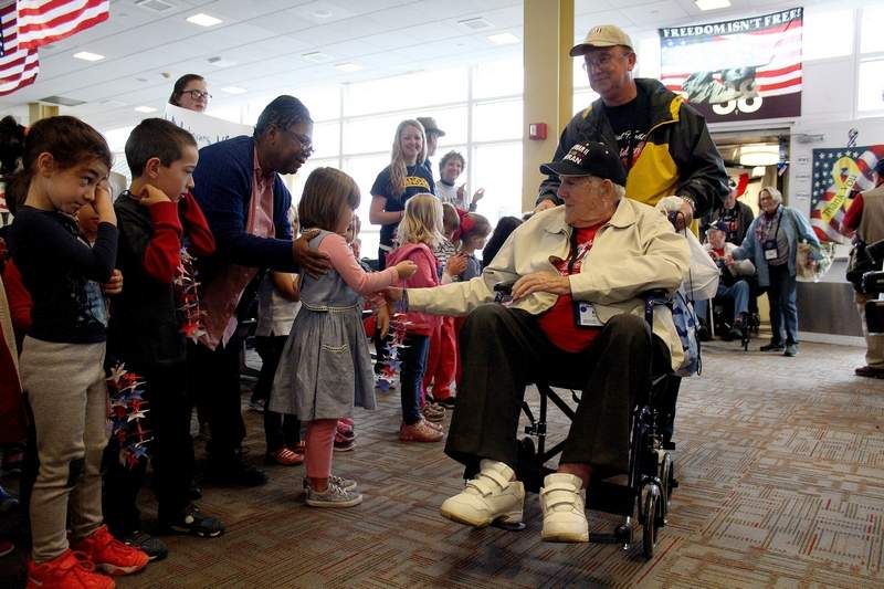 World War II veteran William Thomas of West City, escorted by his son, was greeted by a group of pre-k students, a standing ovation from the airport terminal, and music from a local band, as he deplaned for the inaugural Veterans Honor Flight of Southern Illinois on Tuesday. The welcome was organized by the Honor Flight program, as a way to show veterans that both they and their service are widely appreciated and recognized.