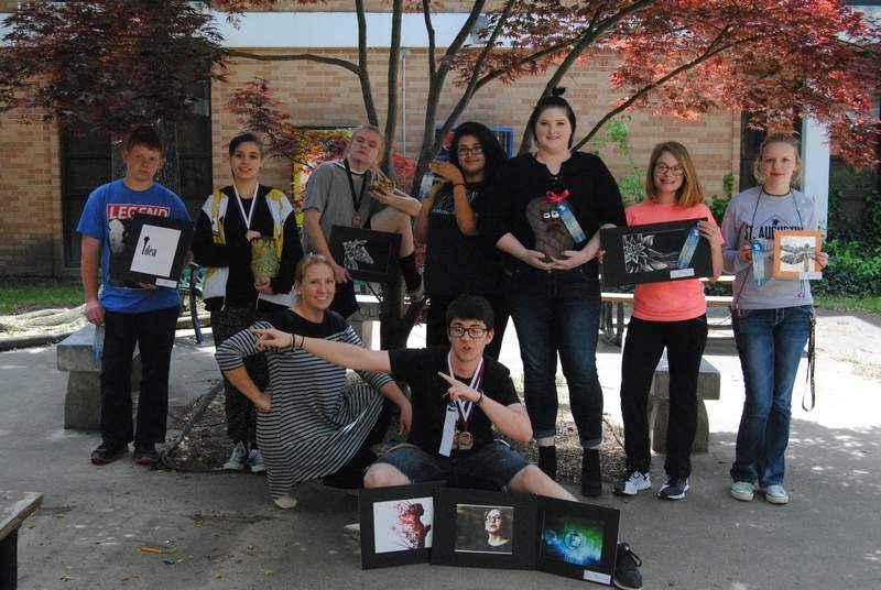 Several BCHS art students earned honors at last week's art competition hosted by Pope County High School. Teacher Amber Akes said the show, which included around 700 entries, adds to the curriculum, giving the students real world experiences in display and  collaboration. Pictured are winners (back) Carter Lingle, Ally Hutchcraft, Dailin James, Maria Hampton, Taytun Pearce, Fallon Dawson, Hannah Dawson, (front) Amber Akes, teacher, and Noah Bishop.
