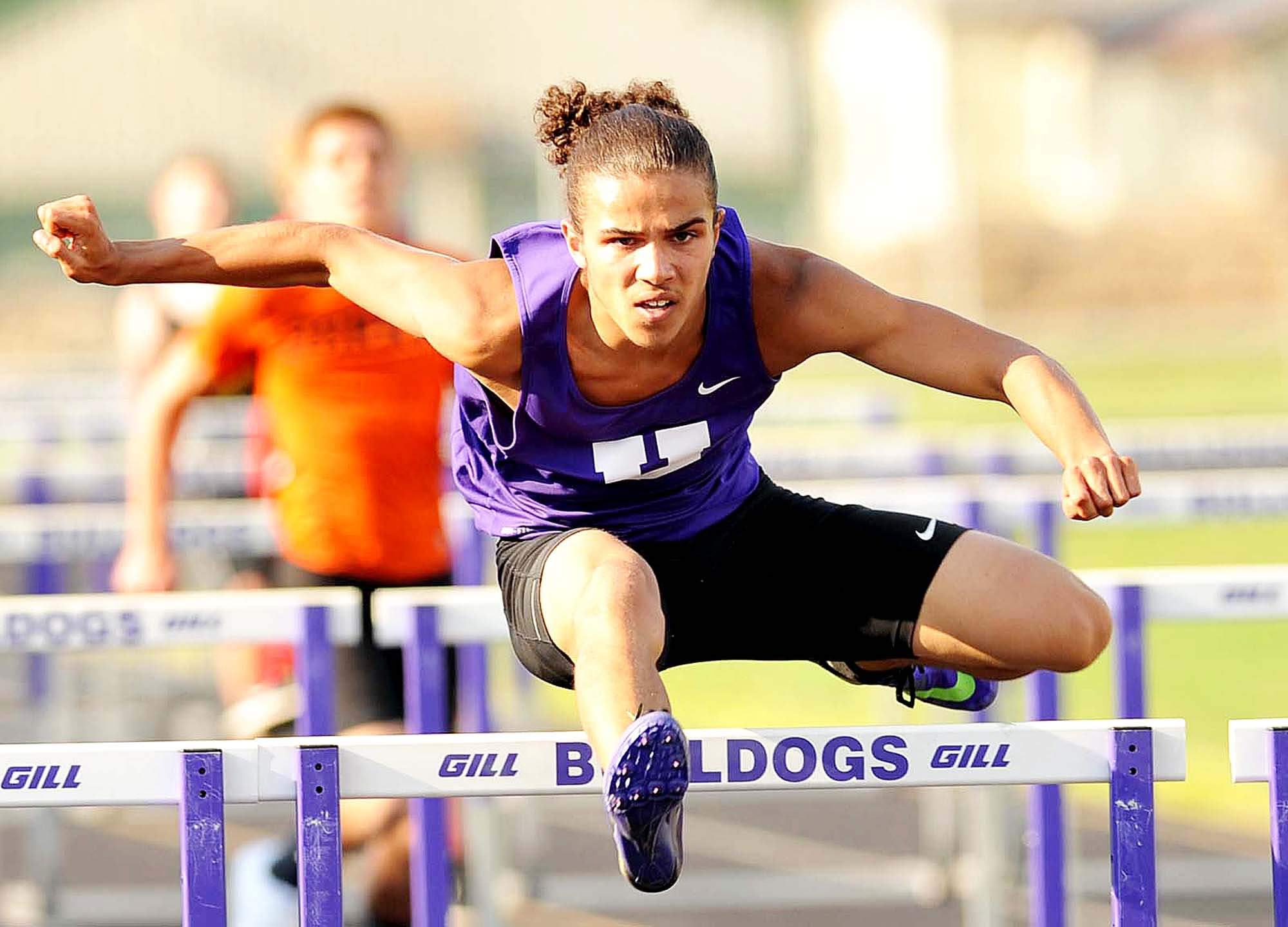 Niko Neal took first place in the 110 meter high hurdles, shown here, the 300 meter intermediate hurdles and the long jump at the Harrisburg Open, held at Taylor Field.