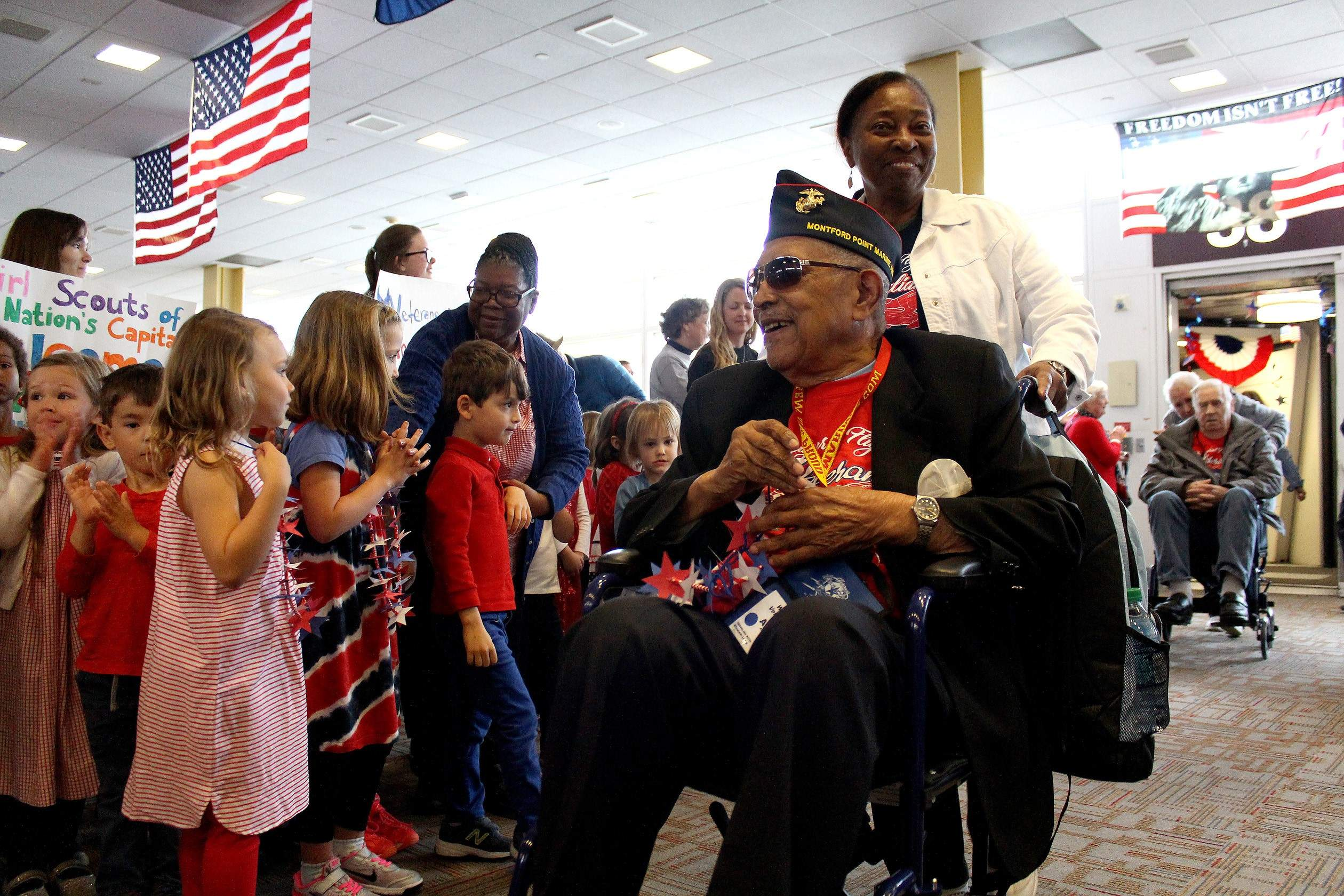 Reverend Archibald Mosely of Carbondale, a World War II veteran, was escorted off of the plane into Washington D.C. by his daughter Elizabeth Lewin, only to be greeted by a group of pre-kindergarten students who presented him with a handmade necklace, a standing ovation from the airport terminal, and music from a local band. Surprise welcomes in D.C. are a staple of the Honor Flight program, which seeks to show veterans the impact and importance of their service for their country.