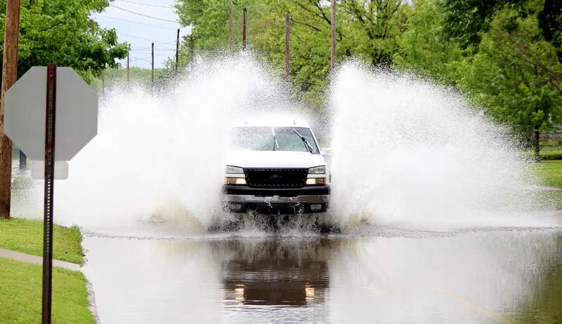 A rebellious truck ignored the cautionary signs on the flooded portion of South Market Street and sped through the area, sending water flying. Heavy storms over the weekend left the low-lying portion of the road flooded.