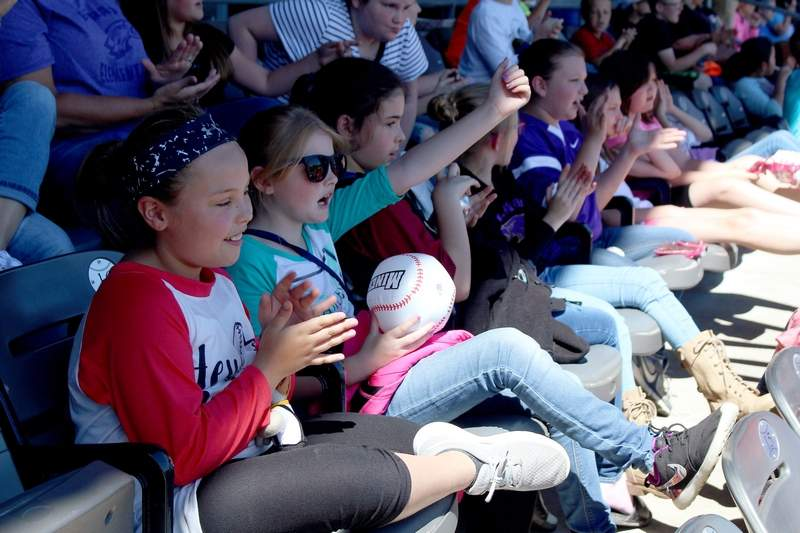 Hannah Farmer (left) and Brooklyn Biggerstaff (right), both fourth graders at Eldorado Elementary School, root for the Southern Illinois Miners during an exhibition game against the Gateway Grizzlies at Rent One Park on Tuesday.
