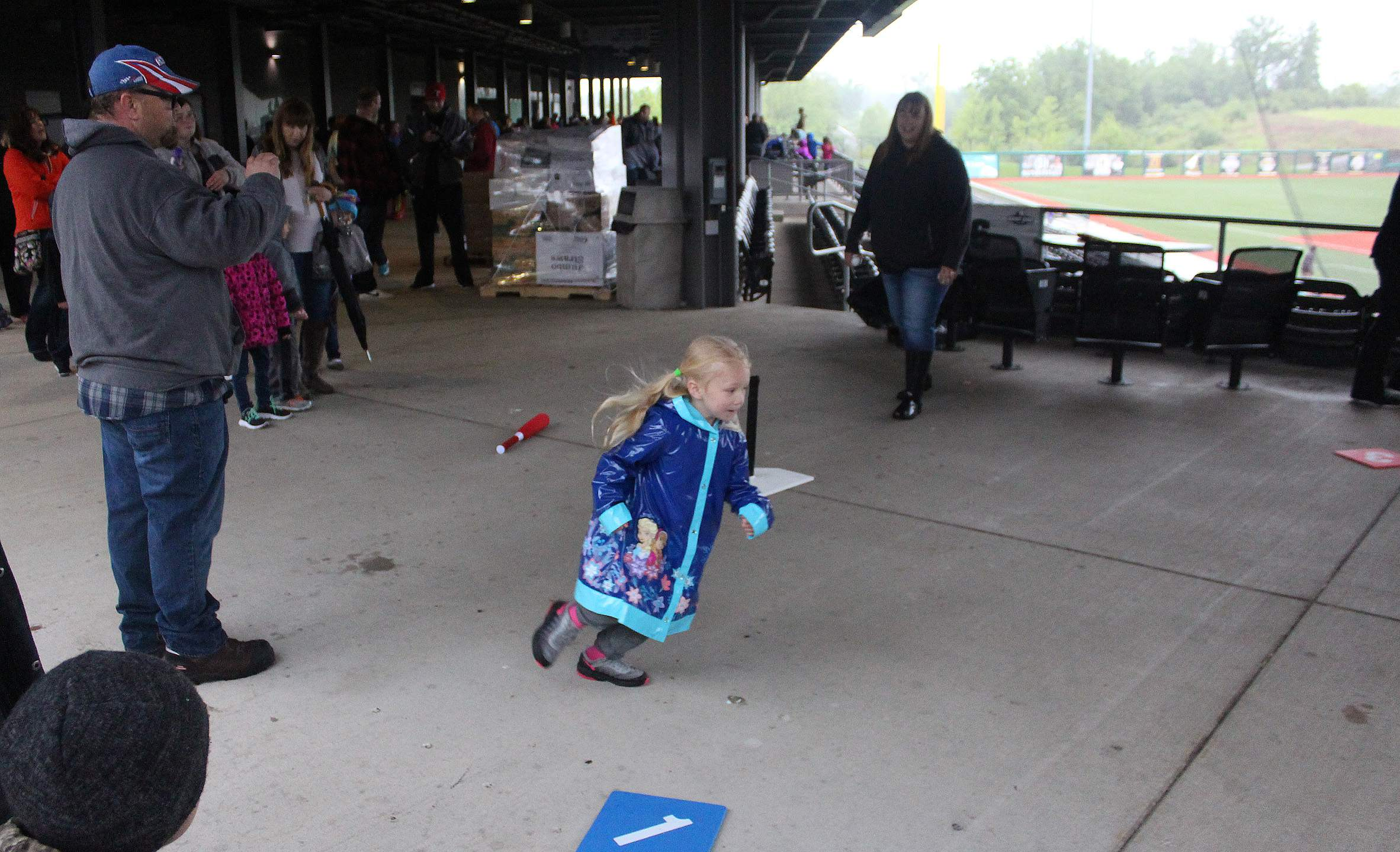 Bristol Williams, 4, of Herrin, rounds the bases on the main concourse at Rent One Park on Thursday, during the Williamson County Early Childhood Cooperative's Family Fun Day. Rain didn't stop the kids in attendance from meeting the mascots of the SI Miners, and even from running the bases in the rain.