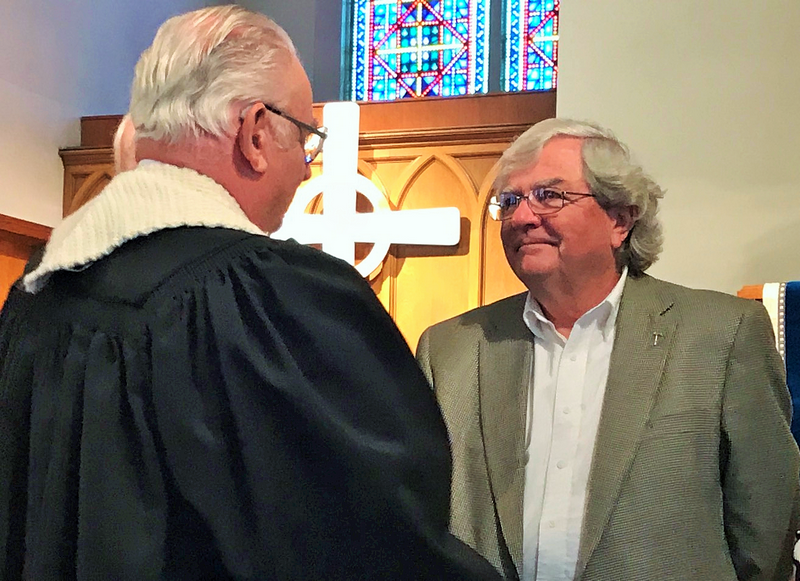 The Rev. Dan Whitfield congratulates Saline County Habitat for Humanity President Bruce Boone during Mission Sunday at First Presbyterian Church in Harrisburg.