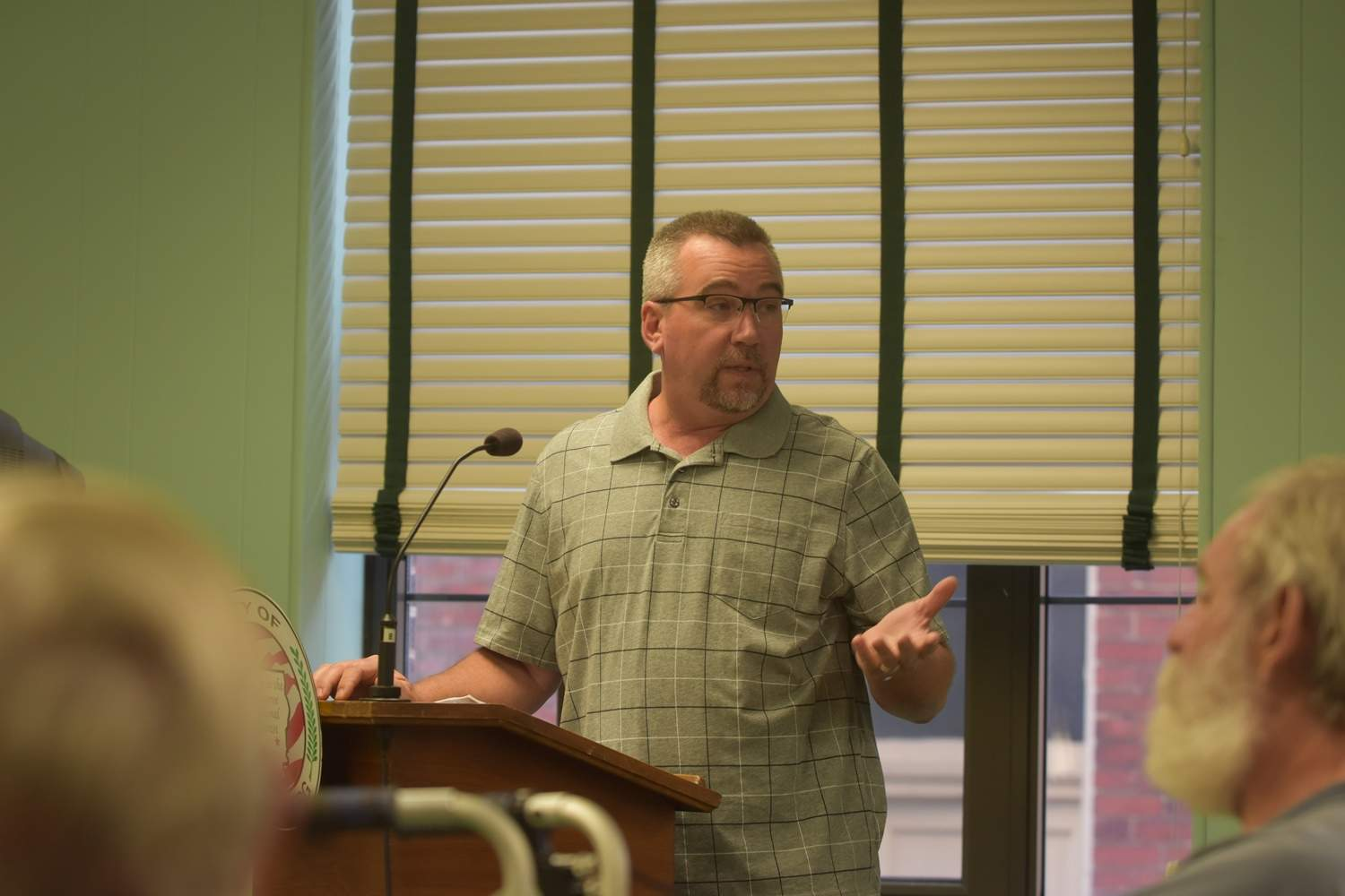 Harrisburg businessman David Crest, who owns Illinois Storage, 815 W. Pine St., addresses city council concerning recent flooding Thursday evening. Crest spoke on behalf of several businessowners who wish to work with the city to continue to reduce potential flooded locations.