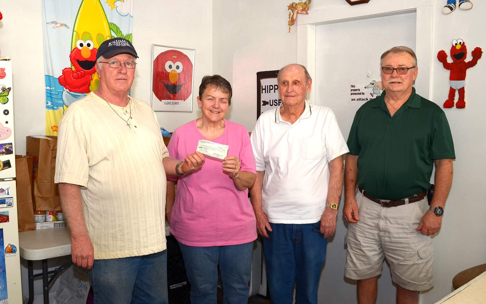 The Knights of Columbus Council 9890, St. Joseph Catholic Church, participated with other chapters in the organization's annual humanitarian project and presented a matching grant of $150 to the Benton/West City Ministerial Alliance. Pictured from left to right are Mike Young, Grand Knight; Vickie Seagle, pantry coordinator; Jim Chady, life member; and Dennis Kinkade, Deputy Grand Knight.