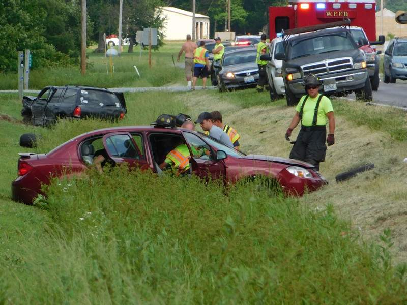 Members of the West Frankfort Fire Department work to extricate 76-year-old Rena Berquez of Zeigler following a two-car collision Wednesday. Berquez was transported to Herrin Hospital with major injuries following the crash.