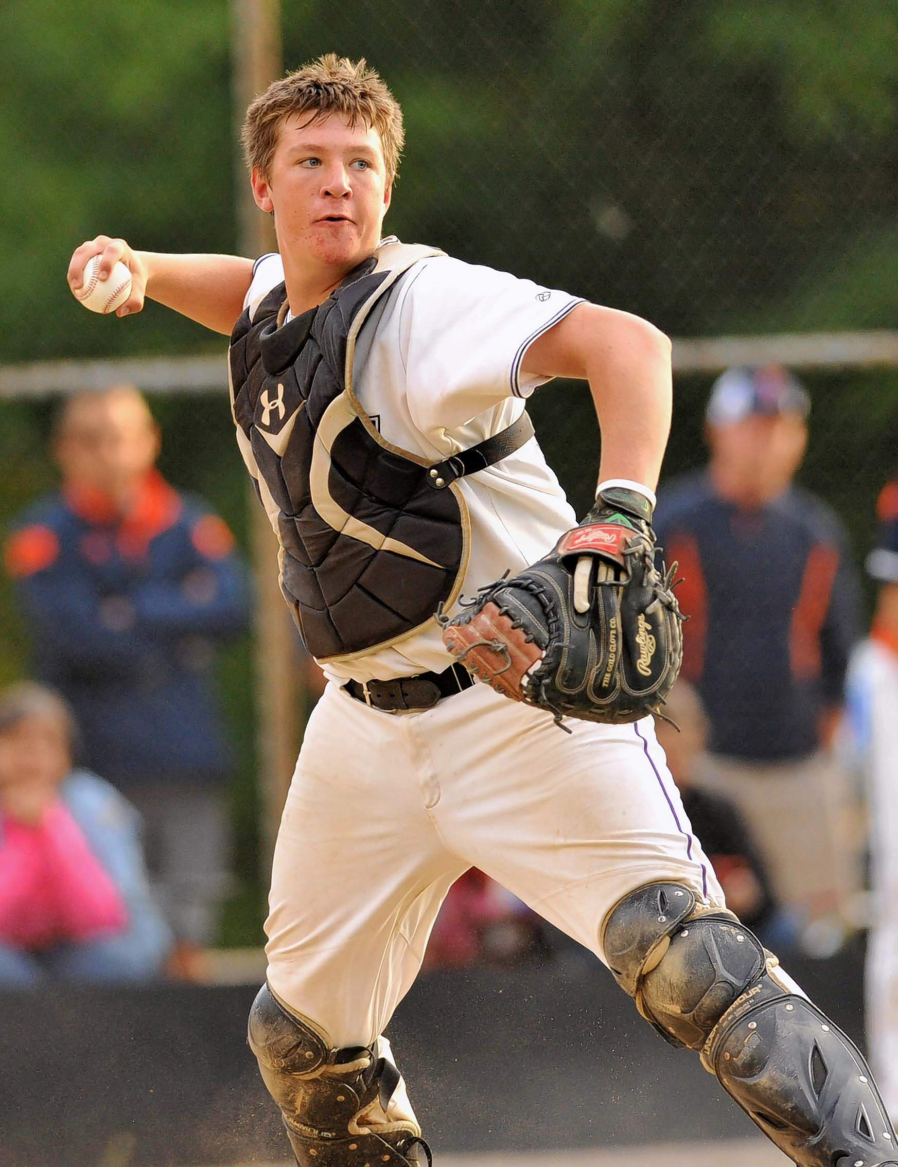 Harrisburg High School freshman catcher Isaac Crabb prepares to cut loose a throw in sectional tournament game action Wednesday night with Carterville.