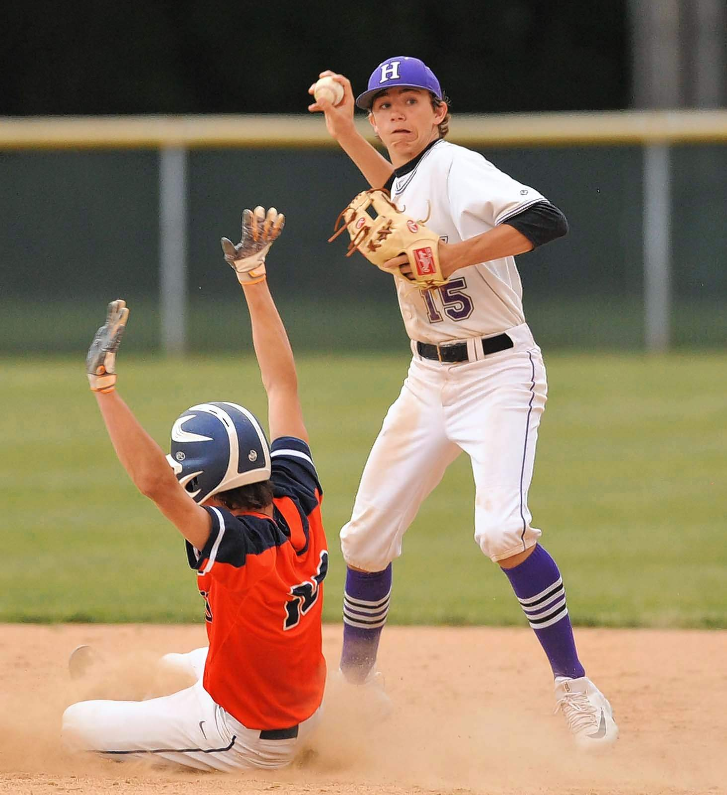 Bulldogs' freshman infielder Will Holland attempts to complete the double play Wednesday against Carterville.