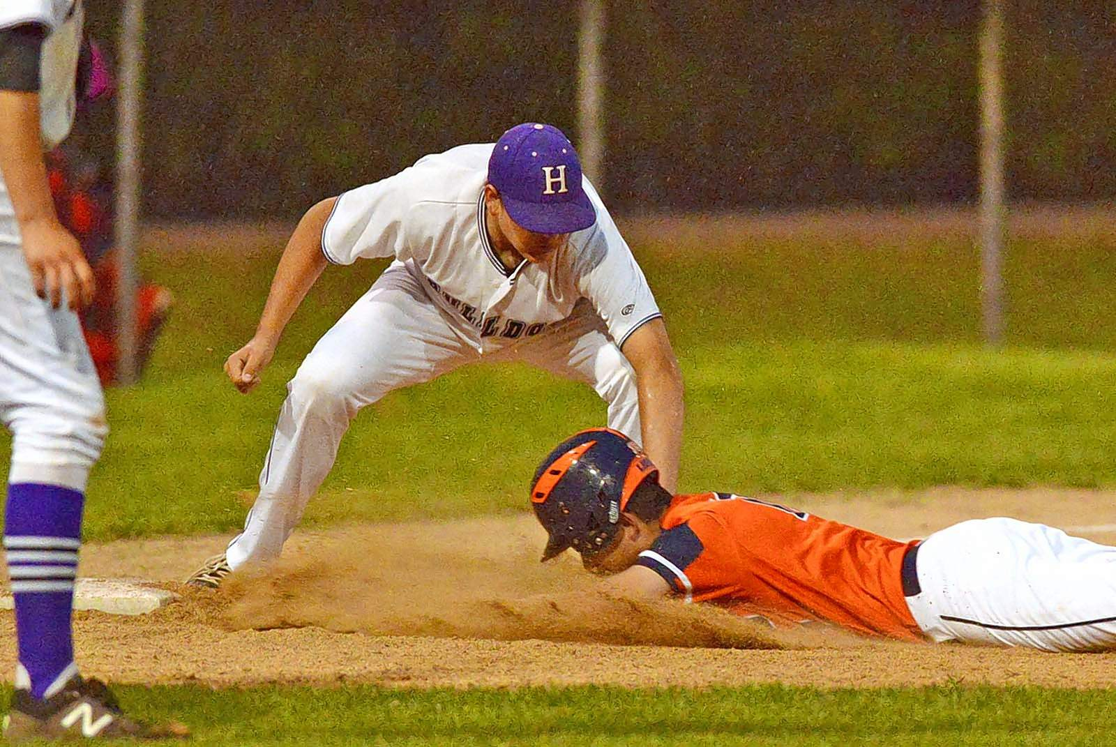 photos by Jeff Jones Harrisburg  junior Dalton Lambert applies the tag and the out in game action Wednesday against Carterville in sectional tournament play at Benton.