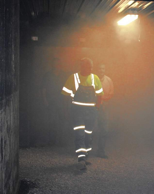 Guests at the ribbon cutting ceremony of the new Mine Simulation Training Facility at SIC tour the building, complete with theatrical smoke.