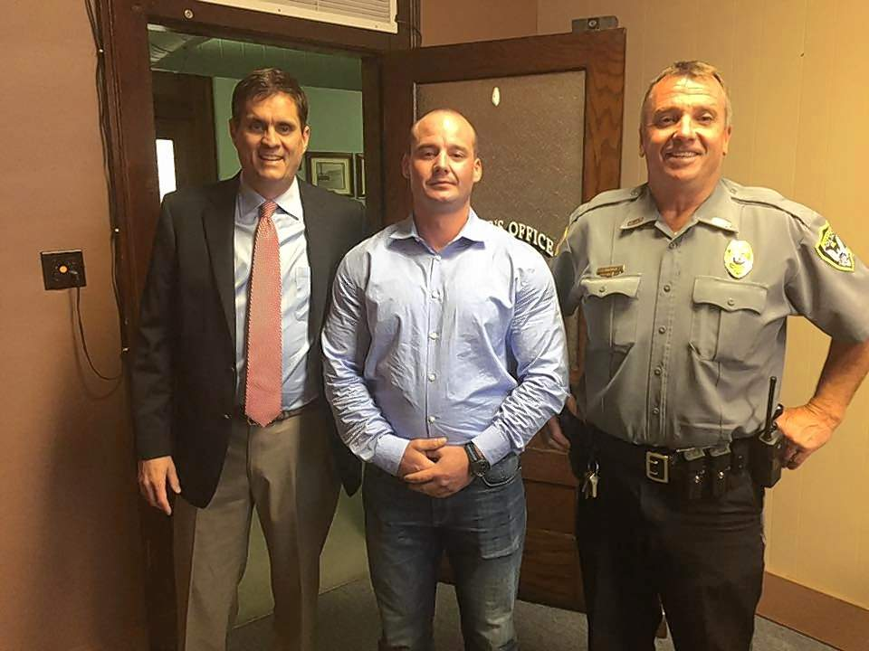 Eric J. Gott, center, is Harrisburg's newest police officer. At left is Harrisburg Mayor John McPeek, with Police Chief David Morris at right.