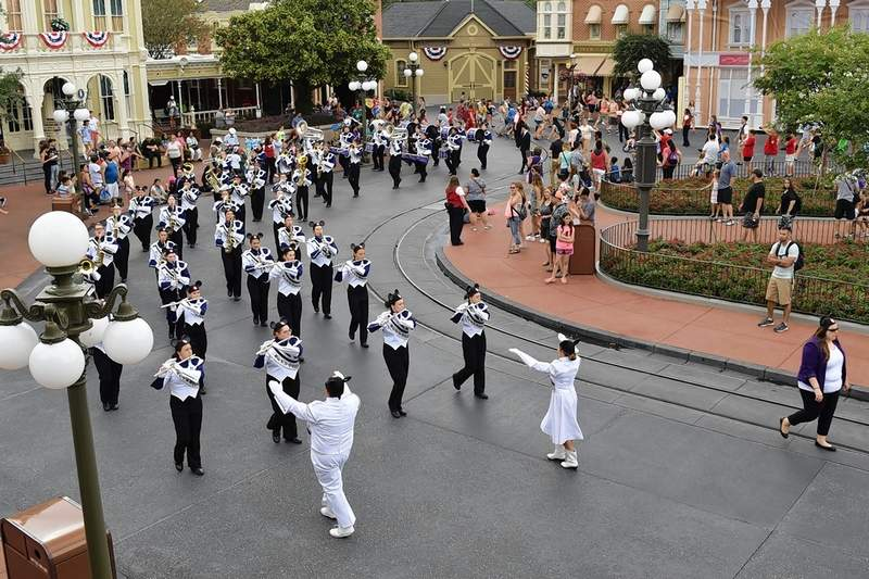 A view from above: Parade marshals Alex McRoy, in white at left, and Chloe Thomas guide the band around the Main Street Square.