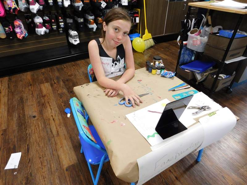 Eleven-year-old Kayleigh Clark set up a face-painting booth at the 'Step Up for Fur-Babies' event at Du Quoin's Shoe Sensation Saturday. Clark's mom, Julie, is an employee at the store. 'She wanted to do something to help, too,' she said.