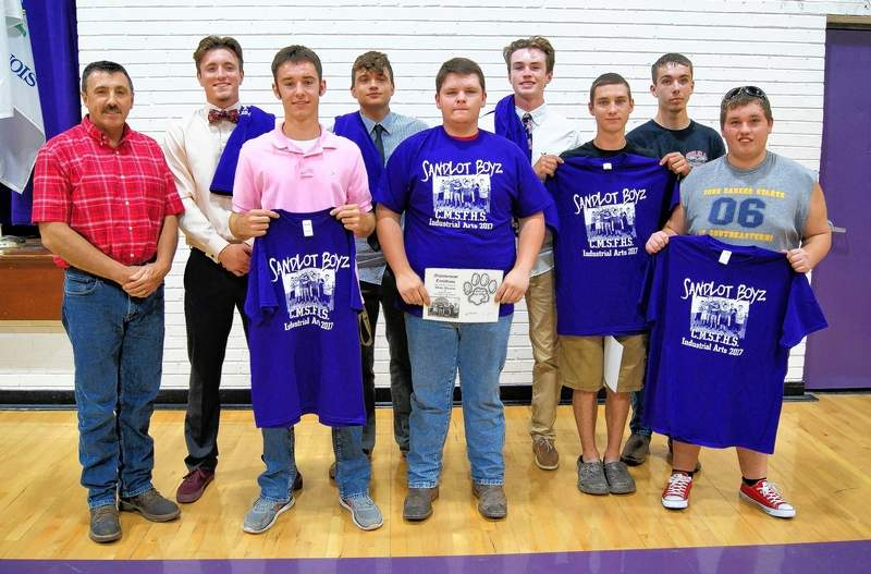 """Retiring industrial arts teacher Randy Boyd presents a special award to his """"Sandlot Boyz,"""" who he has taught for four years. Pictured are Boyd, Justice Hill, Michael Hendricks, Dylan Schwartz, Blake Bynum, Brody Walker, Alex Snodgrass, Christian Pierce and Dalton Hall."""