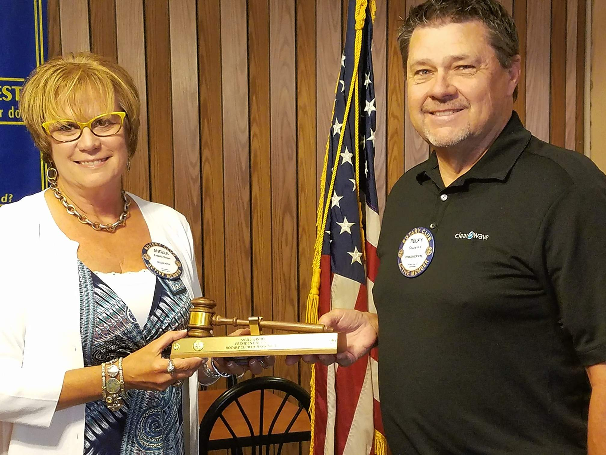 Angela Rowe is presented with a gavel plaque in honor of her two years of service as Harrisburg Rotary Club president. Presenting the award is club member Rocky Hull.