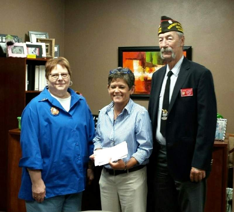 Angela Simmons (center), director of the Anna Veterans Home, accepted a check from VFW District 15 Tuesday afternoon. The check, in the amount of $5,100, was presented by Lynn Smith, president of the District 15 Auxiliary; and Clarence Caraker, District 15 commander.
