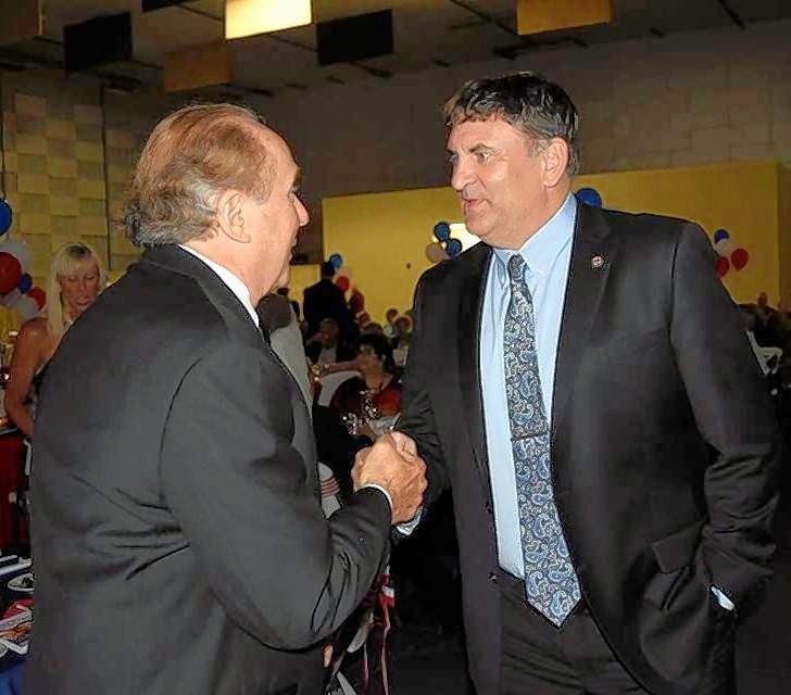 Rep. Dave Severin greets Michael Reagan, after driving over from Springfield to attend the Ronald Reagan Tribute Gala Friday evening. He headed back to Springfield that same night.