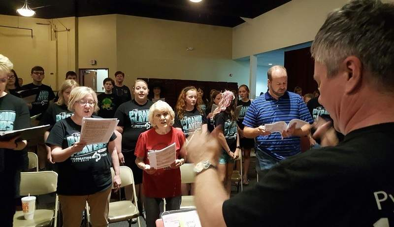 Brian Summers directs a rehearsal of the finale for the Pyramid Players 40th anniversary gala next weekend.