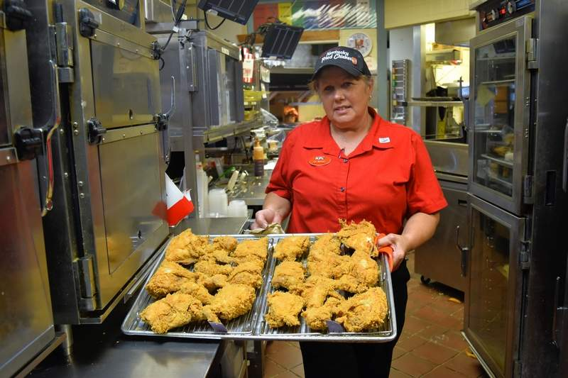 Harrisburg KFC manager Val Mitchell with a fresh tray of fried chicken.